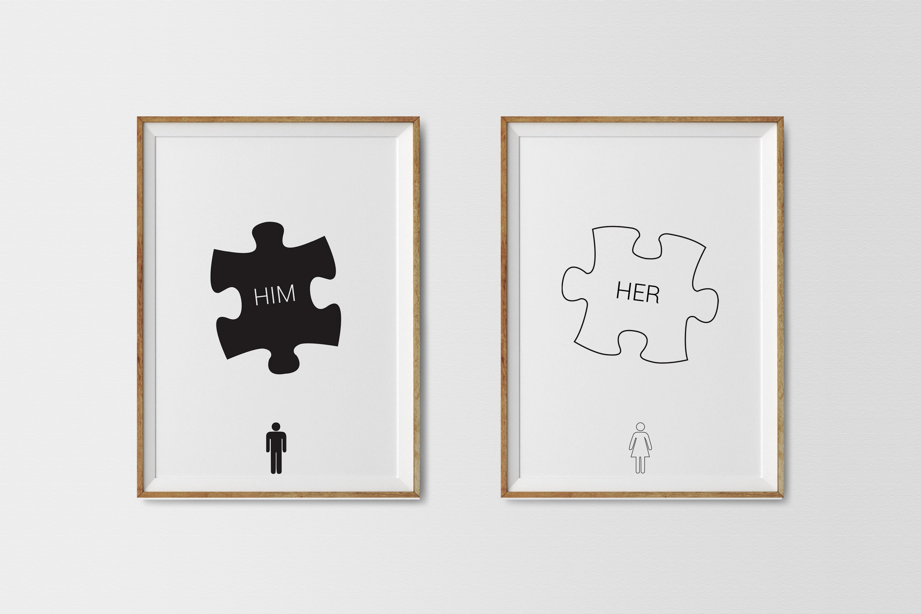 'Him' and 'Her' wall art prints in frames hanging on a wall