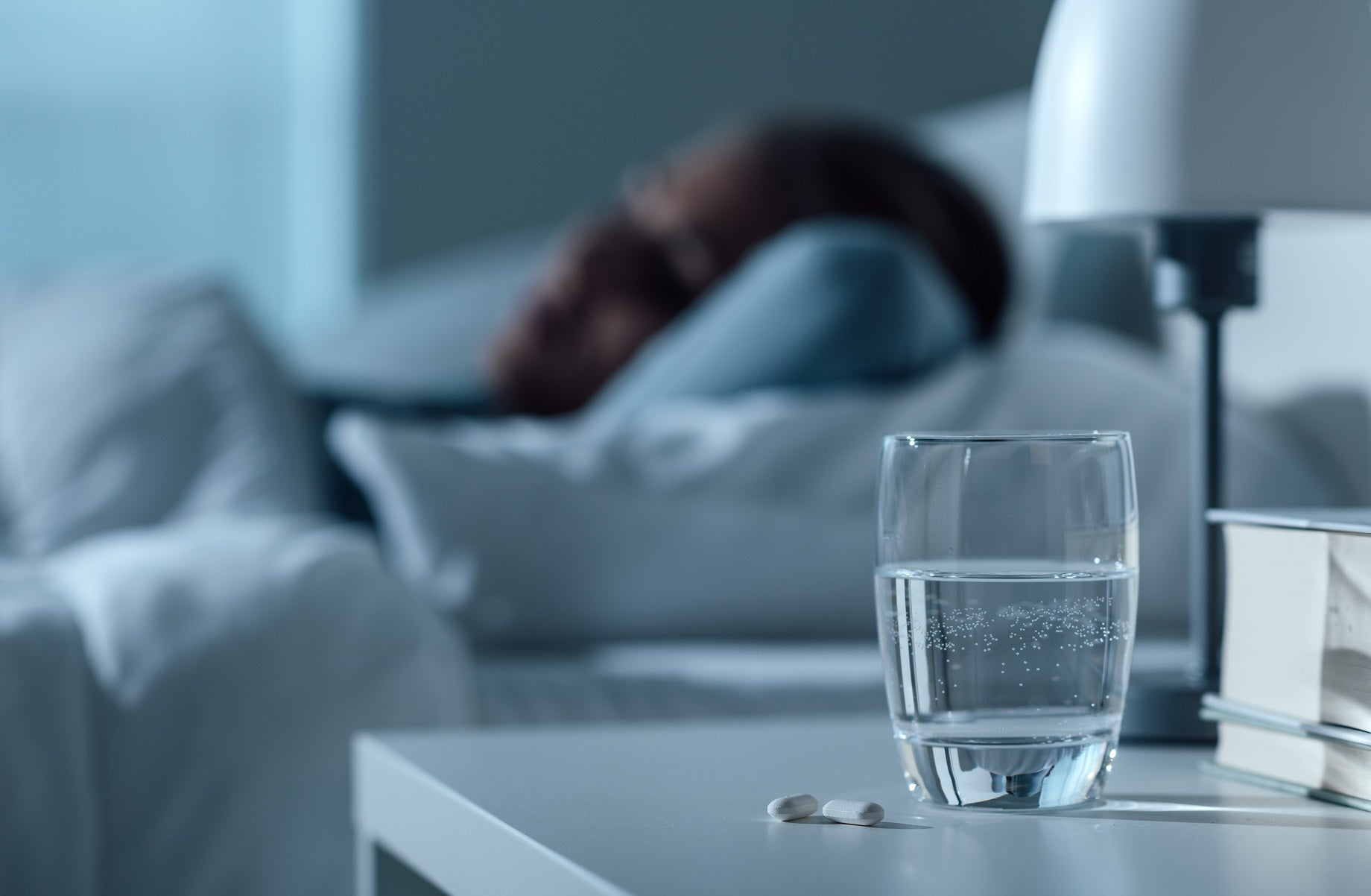 narcolepsy treatment medication next to glass of water on bedside table