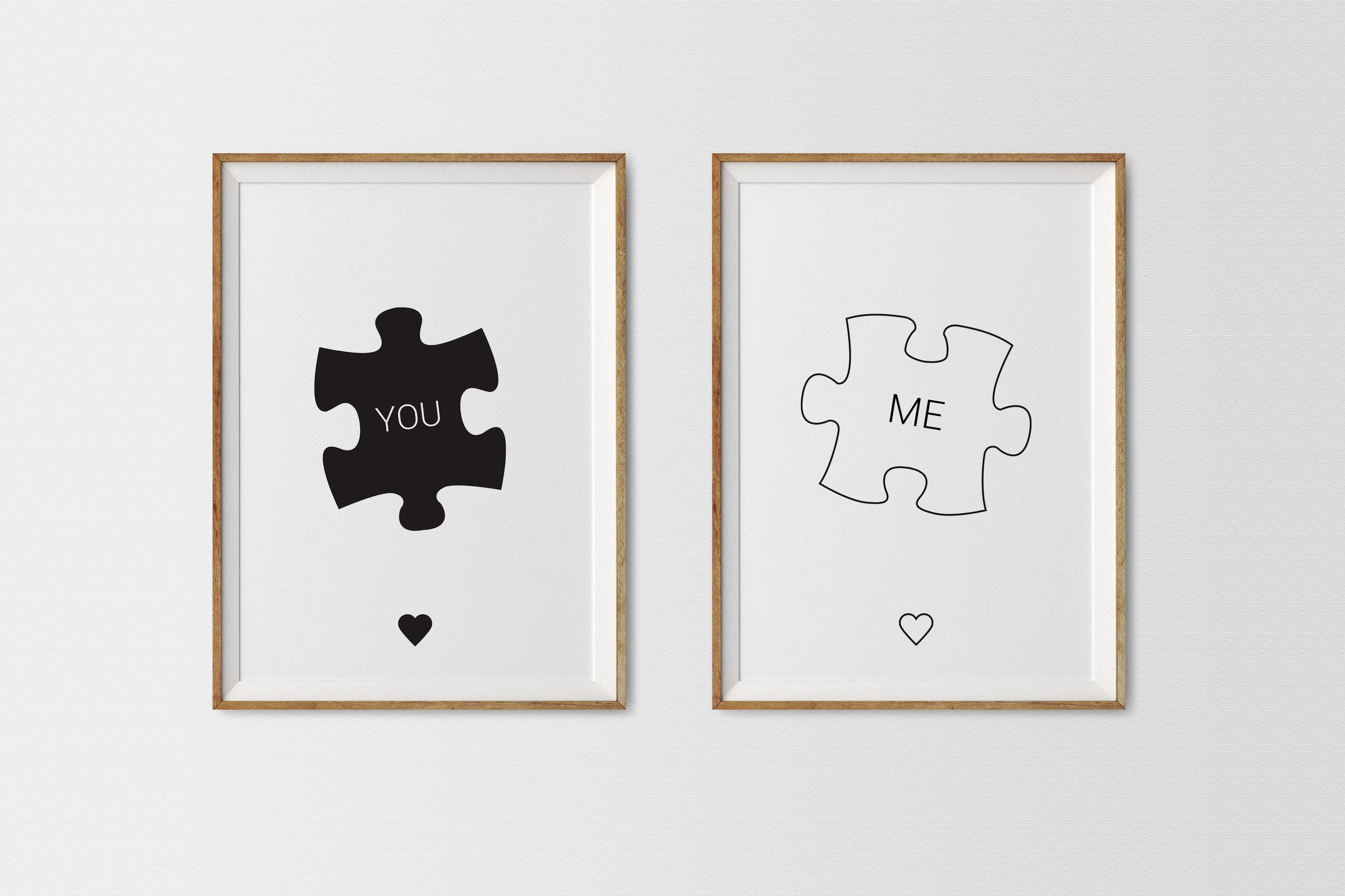 'You' and 'Me' wall art prints in frames hanging on a wall