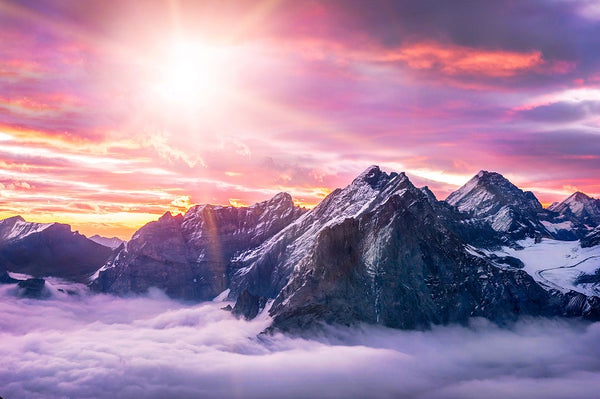 winterscape of a purple and pink sky and mountains