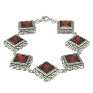 7.5 in - Sterling Silver Princess Cut Red Cubic Zirconia Braided Frame Bracelet