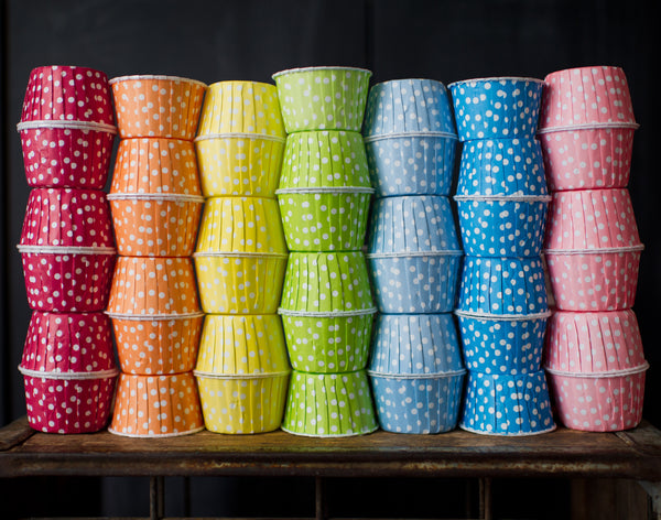 polka dot nut cups or cupcake liners in a rainbow of colors for a party