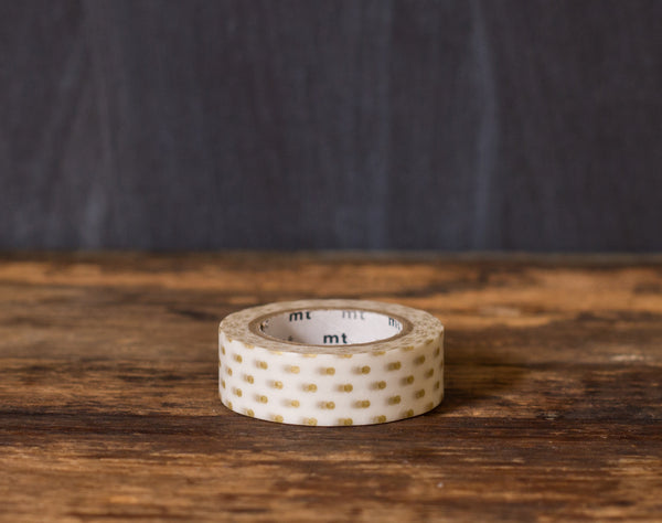gold and white polka dot printed MT Brand Japanese washi tape roll