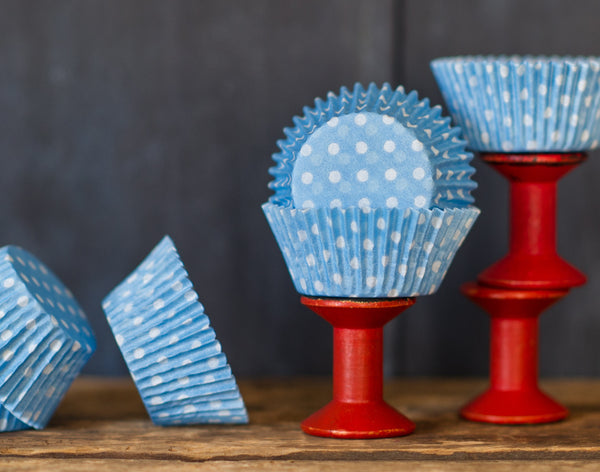 light blue and white polka dot paper cupcake liners for circus party supplies