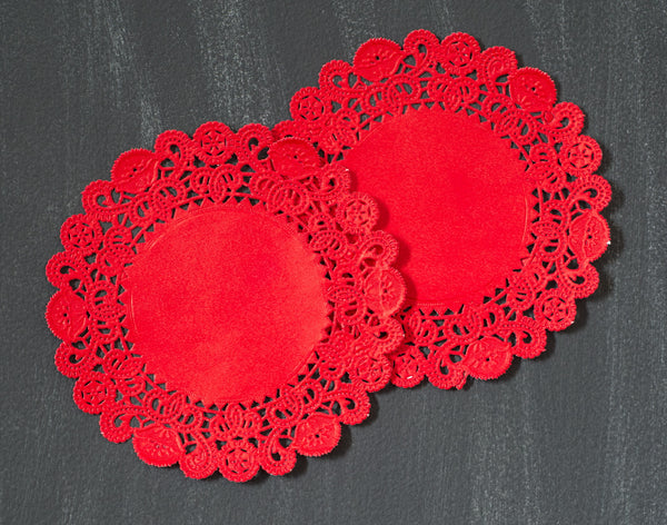 red colored round paper doilies