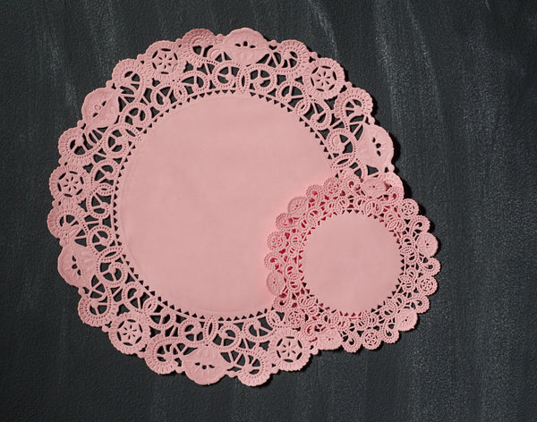 pink colored round paper doilies