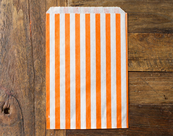 orange and white striped candy, treat, or gift bags for circus party