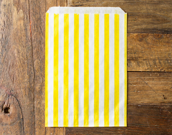 yellow and white striped candy, treat, or gift bags for circus party