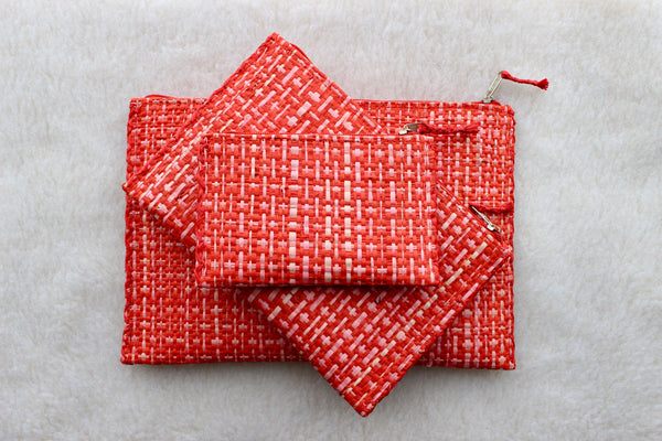 set of 3 hot pink and red raffia woven clutches with leather trim