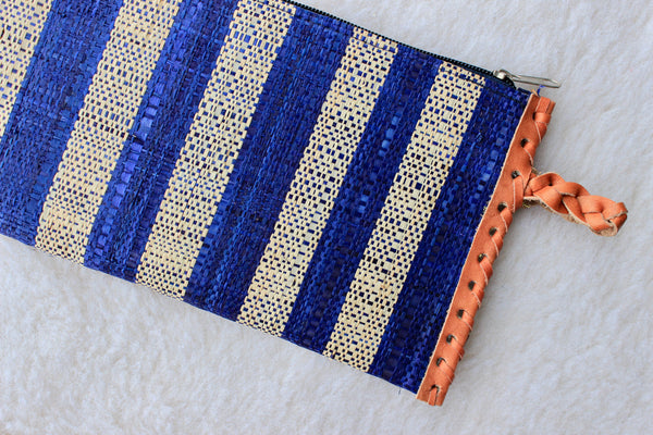 blue and cream raffia woven clutch with leather trim