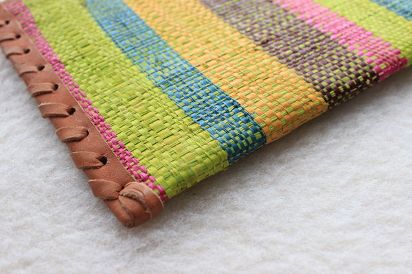 bright multi-colored wide striped raffia woven clutch with leather trim