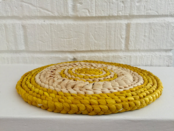 yellow and beige natural circular handwoven trivets