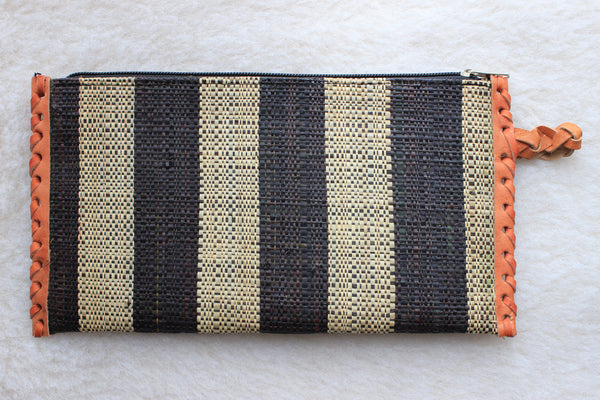 black and cream raffia woven clutch with leather trim