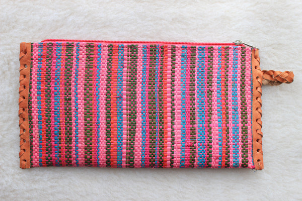 bright pink multi-colored raffia woven clutch with leather trim