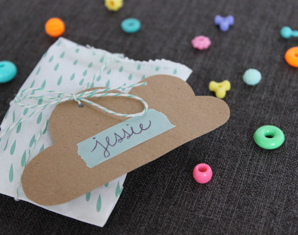 turquoise and white raindrop print modern paper party bags
