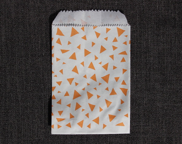 coral and white triangle printed modern mini paper candy, treat, or gift party bags