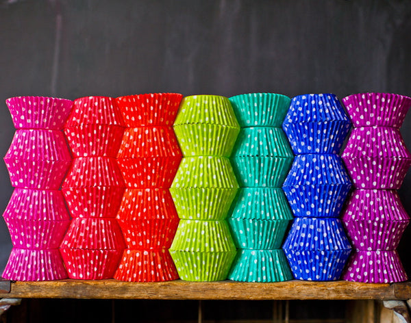 bright polka dot paper cupcake liners in a rainbow of colors for circus party supplies