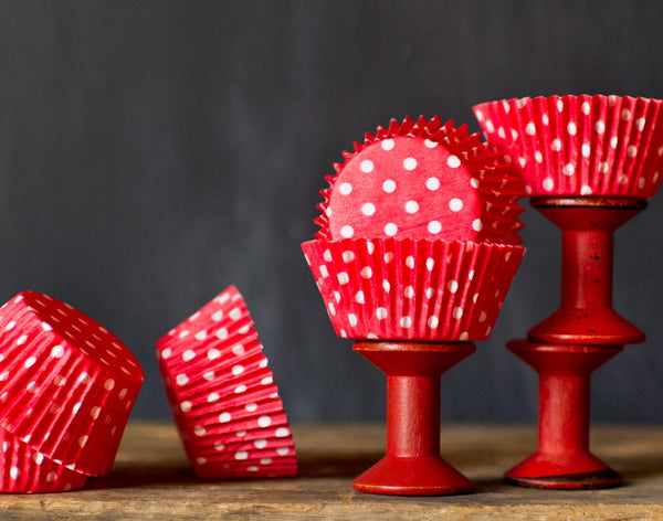 bright red polka dot paper cupcake liners for circus party supplies