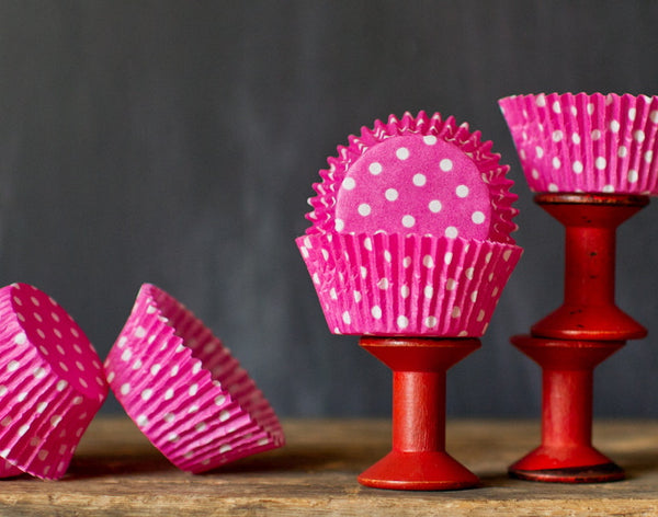 bright hot pink polka dot paper cupcake liners for circus party supplies