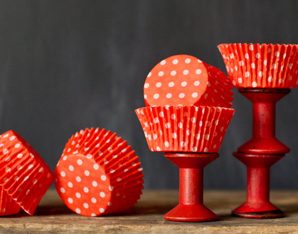 bright orange polka dot paper cupcake liners for circus party supplies