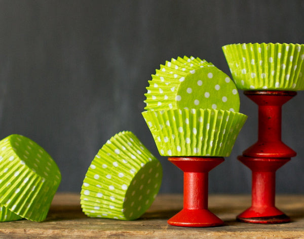 bright lime green polka dot paper cupcake liners for circus party supplies