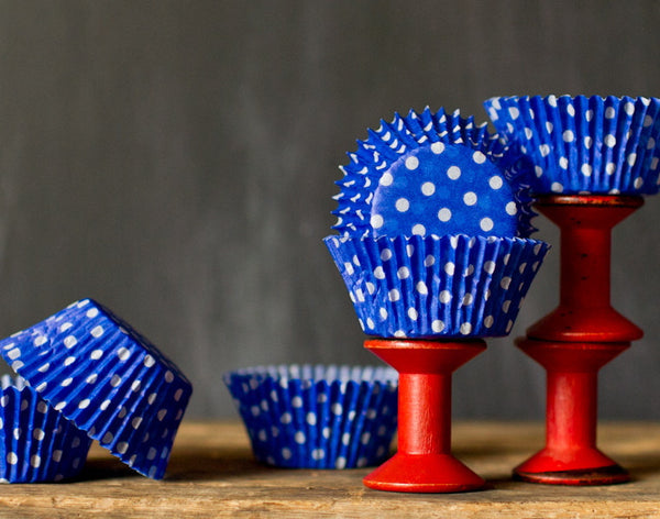 bright blue polka dot paper cupcake liners for circus party supplies