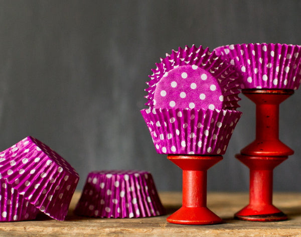 bright purple polka dot paper cupcake liners for circus party supplies