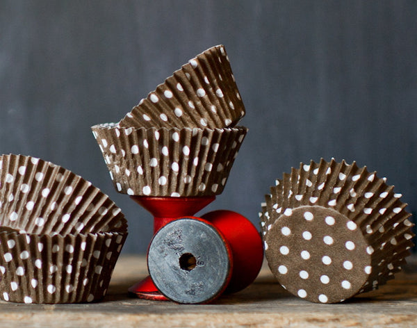 brown and white polka dot paper cupcake liners for circus party supplies