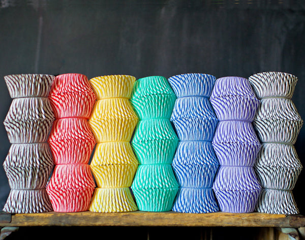 striped paper cupcake liners for circus party supplies in a rainbow of colors