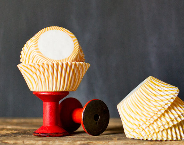 yellow and white striped paper cupcake liners for circus party supplies