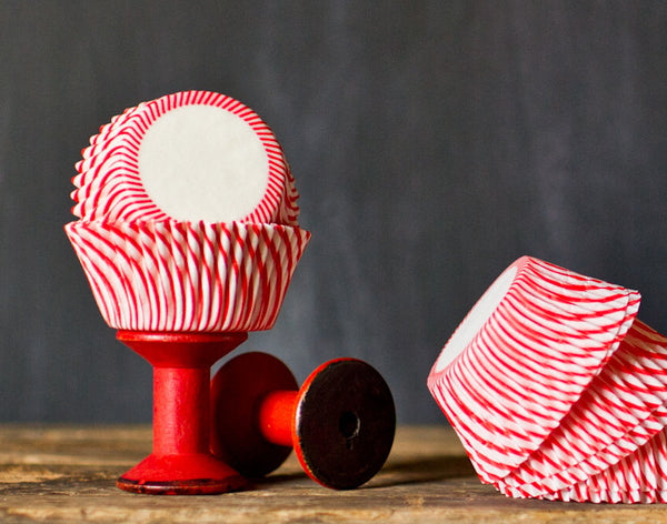 red and white striped paper cupcake liners for circus party supplies