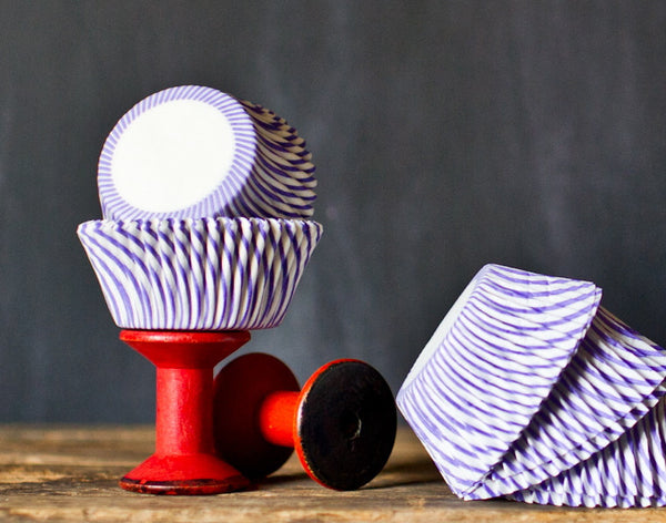 purple and white striped paper cupcake liners for circus party supplies