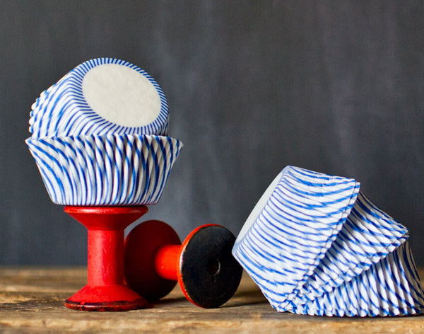 blue and white striped paper cupcake liners for circus party supplies