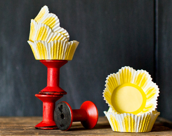 yellow and white pastel tulip shaped paper cupcake liners for Easter party supplies