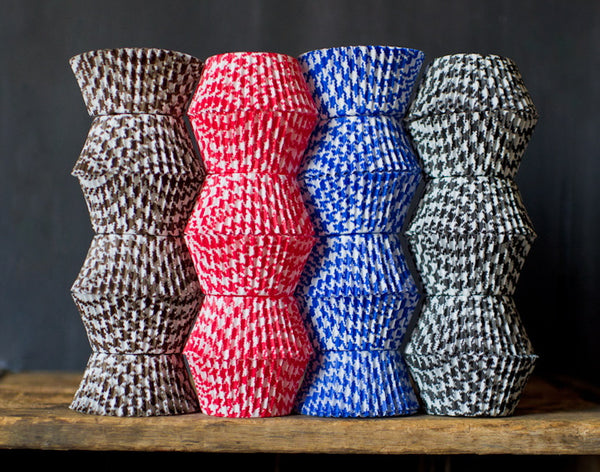red, blue, brown, and black houndstooth printed paper cupcake liners