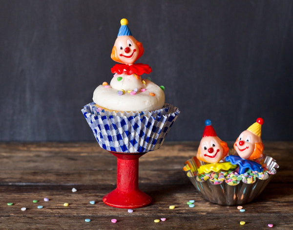 gingham paper cupcake liners in a rainbow of colors with retro clown toppers
