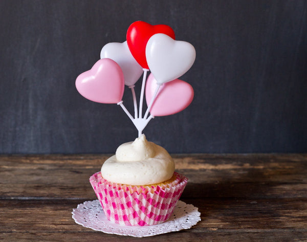 hot pink and white gingham paper cupcake liners for Valentines Day with heart toppers
