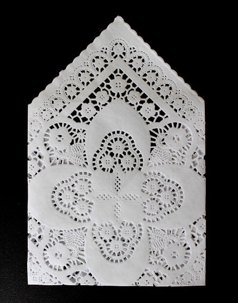 white square paper doilies to make wedding invitation envelopes