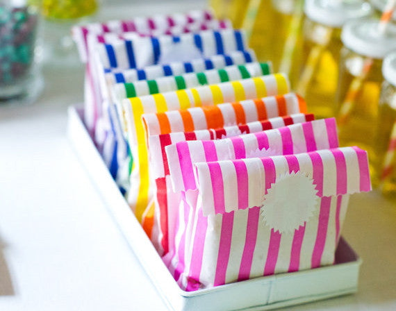 rainbow striped candy, treat, or gift bags for circus party