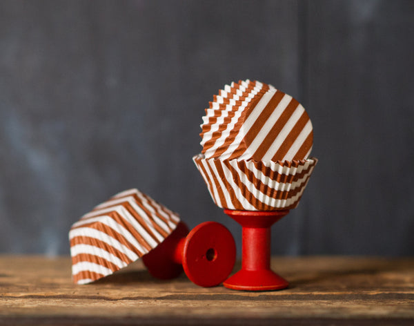 brown and white striped paper cupcake liners for circus party supplies