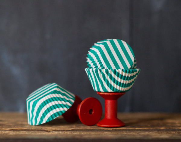 green and white striped paper cupcake liners for circus party supplies