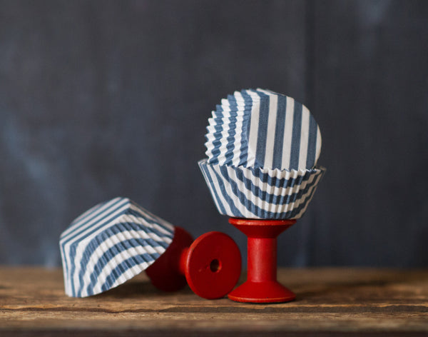 grey and white striped paper cupcake liners for circus party supplies