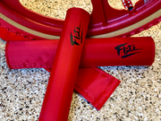 old school red bmx padset shown with red tuff wheel