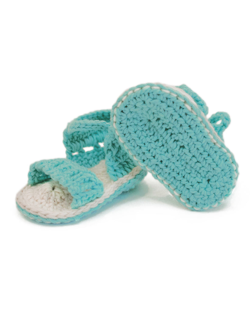 Our baby booties and sandals are crafted to keep little feet cozy, whatever the weather, from crawling to taking their first steps. Infant shoes are inspired by our most popular adult styles, then cast in tiny sizes, including sheepskin baby boots, little chukkas, and baby moccasins.