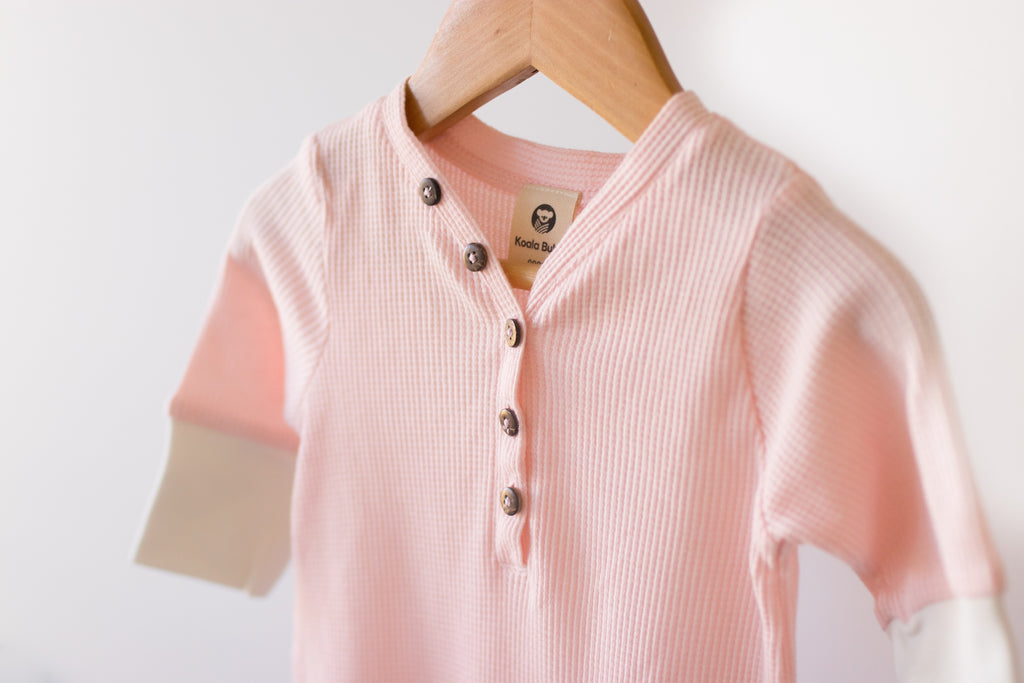 baby romper in blush certified organic