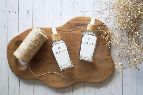 two virgin coconut oil bottles by drop