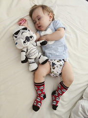 sleeping baby wearing star wars cloth nappy