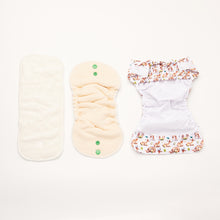 Load image into Gallery viewer, flatlay of bamboo and hemp inserts and open newborn nappy shell