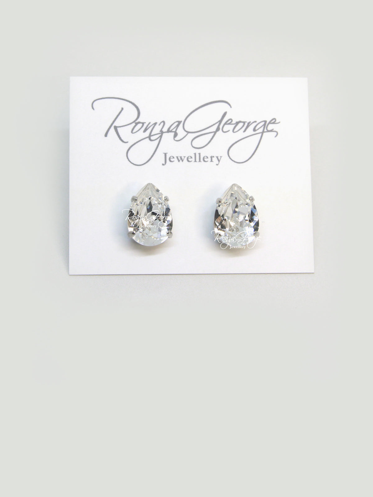 Titi - Rhodium Plated Clear Swarovski Crystal Pear Studs