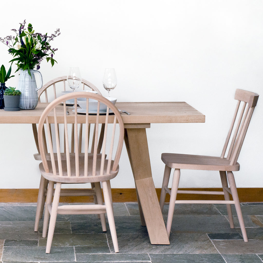 Solid Oak X-frame dining table with leaning oblique legs